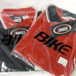 2 XL Red and black Golf Shirts, 6 XL Black and Red golf shirts; $2 each