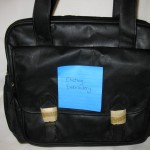 Black Travel Bag with pre-existing embroidery, $5 each, 8 available